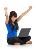 Happy and lucky young woman with laptop Royalty Free Stock Photos