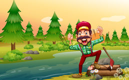 A happy lumberjack at the riverbank Royalty Free Stock Images