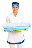 Happy maid ready to change bed Royalty Free Stock Photography
