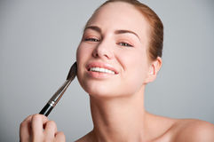 Happy makeup applying Stock Images