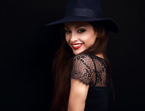 Happy makeup woman in fashion blue hat smiling toothy on dark bl Stock Photo