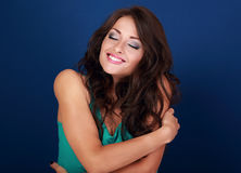 Happy makeup woman hugging herself with natural emotional enjoyi. Ng face. Love concept of yourself body Stock Images