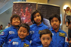Happy Malay children visiting JAXA open-house. JAXA organised an open-house on the 16th of October 2010 which enables the school children to visit JAXA Stock Photos