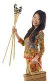 Happy Malay woman. Happy young Malay woman ready to celebrate Hari Raya Aidilfitri / Eid ul-Fitr stock image