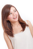 Happy Chinese woman in white dress looking up Stock Image