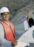 Happy Male Architect Holding Blueprint Stock Photo