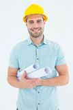 Happy male architect holding blueprints. Portrait of happy male architect holding blueprints on white background Stock Photography
