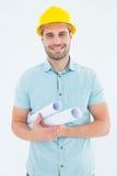 Happy male architect holding blueprints Stock Photography