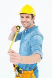 Happy male architect holding tape measure Stock Image