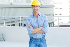 Happy male architect standing arms crossed Stock Image