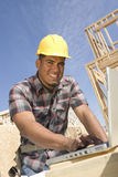 Happy Male Architect Using Laptop Royalty Free Stock Photography
