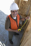 Happy Male Architect Working On Framework Royalty Free Stock Photography