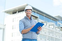 Happy male architect writing on clipboard Stock Photography
