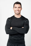 Happy male athlete with folded arms royalty free stock photo