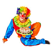 Happy male birthday clown holding cake. Royalty Free Stock Photography