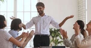 Happy male boss and overjoyed diverse team celebrate triumph