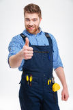 Happy male builder showing thumb up Stock Images