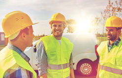 Happy male builders in high visible vests outdoors Stock Images