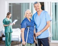 Happy Male Caretaker And Disabled Senior Woman Stock Photography
