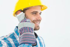 Happy male carpenter using cellphone Stock Image