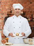 Happy male chef cook baking Royalty Free Stock Photography