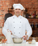 Happy male chef cook baking Stock Image