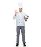 Happy male chef cook with cloche showing ok sign Stock Images