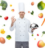 Happy male chef cook with cloche showing ok sign Royalty Free Stock Image