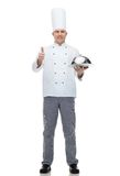Happy male chef cook with cloche showing thumbs up Royalty Free Stock Photography