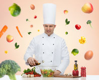 Happy male chef cook cooking food Royalty Free Stock Photo