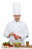 Happy male chef cook cooking food Stock Images