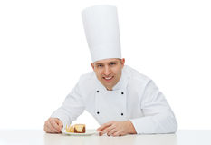 Happy male chef cook with dessert Stock Photos