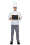 Happy male chef cook holding blank menu board Stock Image