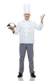 Happy male chef cook holding cloche Stock Photography