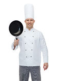 Happy male chef cook holding frying pan Royalty Free Stock Photo