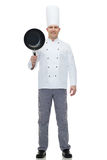 Happy male chef cook holding frying pan Stock Photography