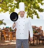 Happy male chef cook holding frying pan Royalty Free Stock Photos