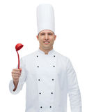 Happy male chef cook holding ladle Stock Photography