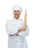 Happy male chef cook holding rolling pin Stock Image