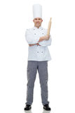 Happy male chef cook holding rolling pin Royalty Free Stock Images
