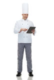 Happy male chef cook holding tablet pc Stock Image