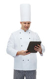 Happy male chef cook holding tablet pc Stock Photos