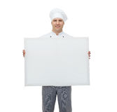 Happy male chef cook holding white blank big board Stock Image