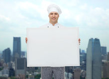 Happy male chef cook holding white blank big board Royalty Free Stock Photos
