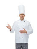 Happy male chef cook inviting Stock Image