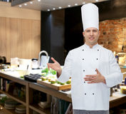 Happy male chef cook inviting. Cooking, profession and people concept - happy male chef cook inviting Stock Photography