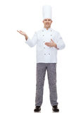 Happy male chef cook inviting Stock Photo