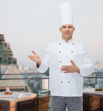 Happy male chef cook inviting Stock Images