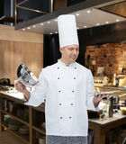Happy male chef cook opening cloche Stock Images