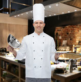 Happy male chef cook opening cloche Royalty Free Stock Photo